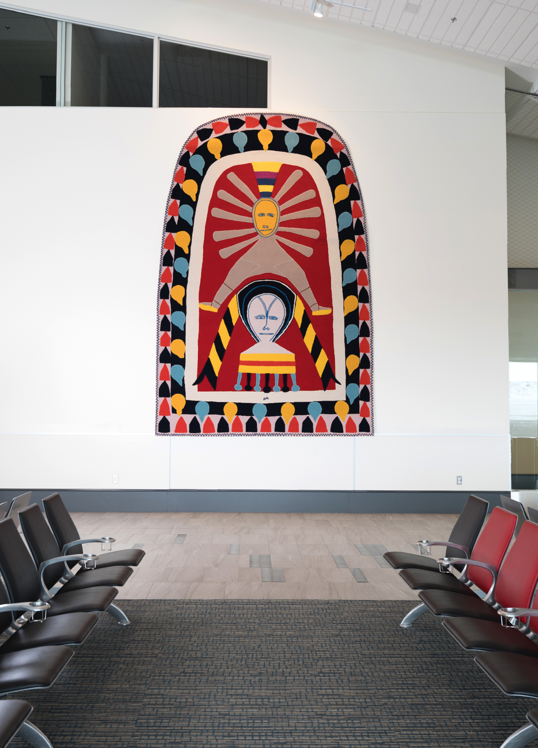 """- """"The bold use of colour and choice of symmetry in Jessie Oonark's design is strong and powerful. The composition of the overall artwork focuses on the central character, who is said to represent a Sun God.""""Kayla Bortolotto, Creative Matters Designer(Original artwork by Jessie Oonark. Canadian (Baker Lake), 1906–1985. Untitled, c.1972–1973. Wool felt on wool duffle. Government of Nunavut Fine Art Collection. On long-term loan to the Winnipeg Art Gallery, 2.76.2)"""