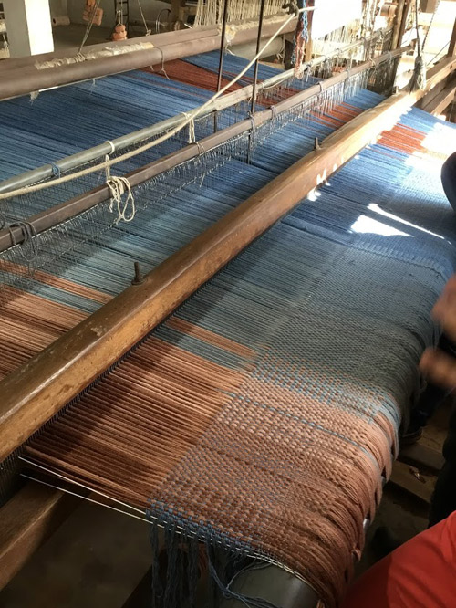 A prototype of the Creative Matters flatweave on the loom in India.