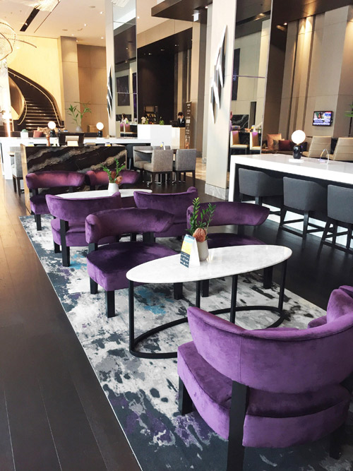 The Creative Matters rug in the dining area of the Marriott included a touch of violet to connect with the seating fabric.