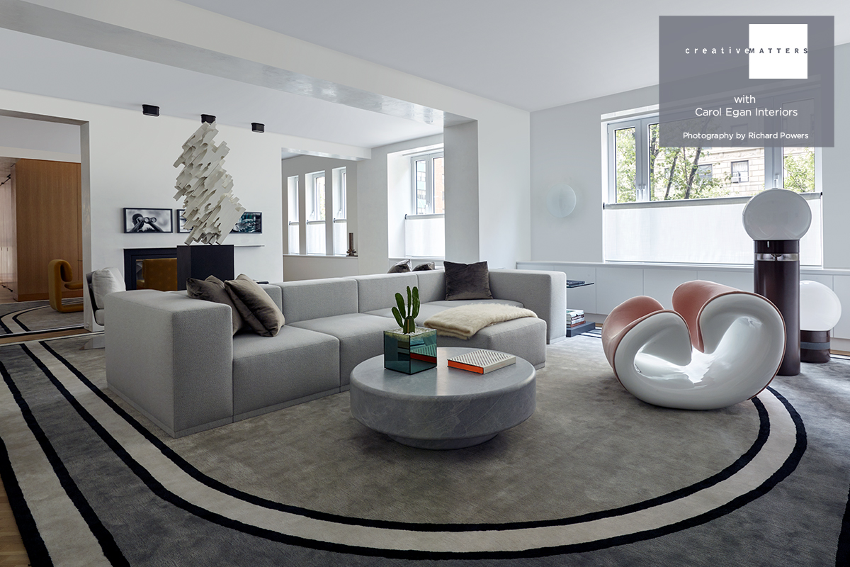 """When Carol Egan Interiors approached us they had already created the design for these corresponding dining and living room rugs. Working with us for the first time, they asked that we make the refined design fit perfectly within the space. Other requirements were to achieve a sumptuous residential texture and to deliver and install the rugs within a tight timeline dictated by the delivery of the bespoke furniture. To meet these requirements, we decided on the handtufted technique from India. Installing the rugs was no small feat. They were so large (16'8"""" x 13'3"""" and 16'8"""" x 22'11"""") that a specialty scaffold was required to hoist them up through a bedroom window. The end result was a splendid way to distinguish the two rooms with ease and conviction.  Project: dining and living room rugs for a New York residence Rug: wool and viscose handtufted in India Interior Designer: Carol Egan Interiors Creative Matters Designer: Kayla Bortolotto"""