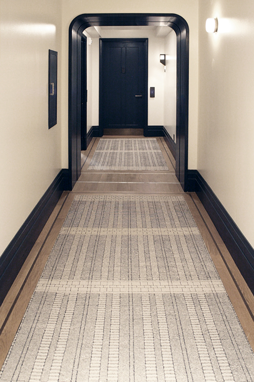 Handtufted in Thailand in 100% wool, the 44 Creative Matters corridor inset carpets feature a fine grid design. Crisp craftmanship with textural details that celebrate the handmade construction in a subtle yet stunning manner.