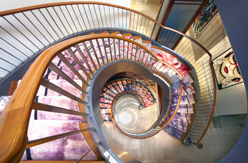 A grand view of the spiral staircase by Creative Matters and Crayon Design. Photo: Christopher Lawson Photography