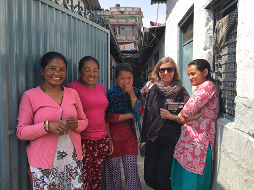 Carol in Nepal with some of the weavers who handknot our rugs.