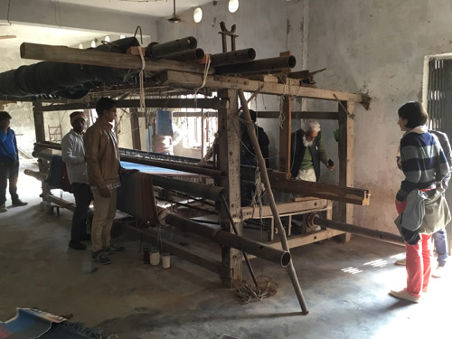 Anna (right) supervising the set-up of the loom in India.