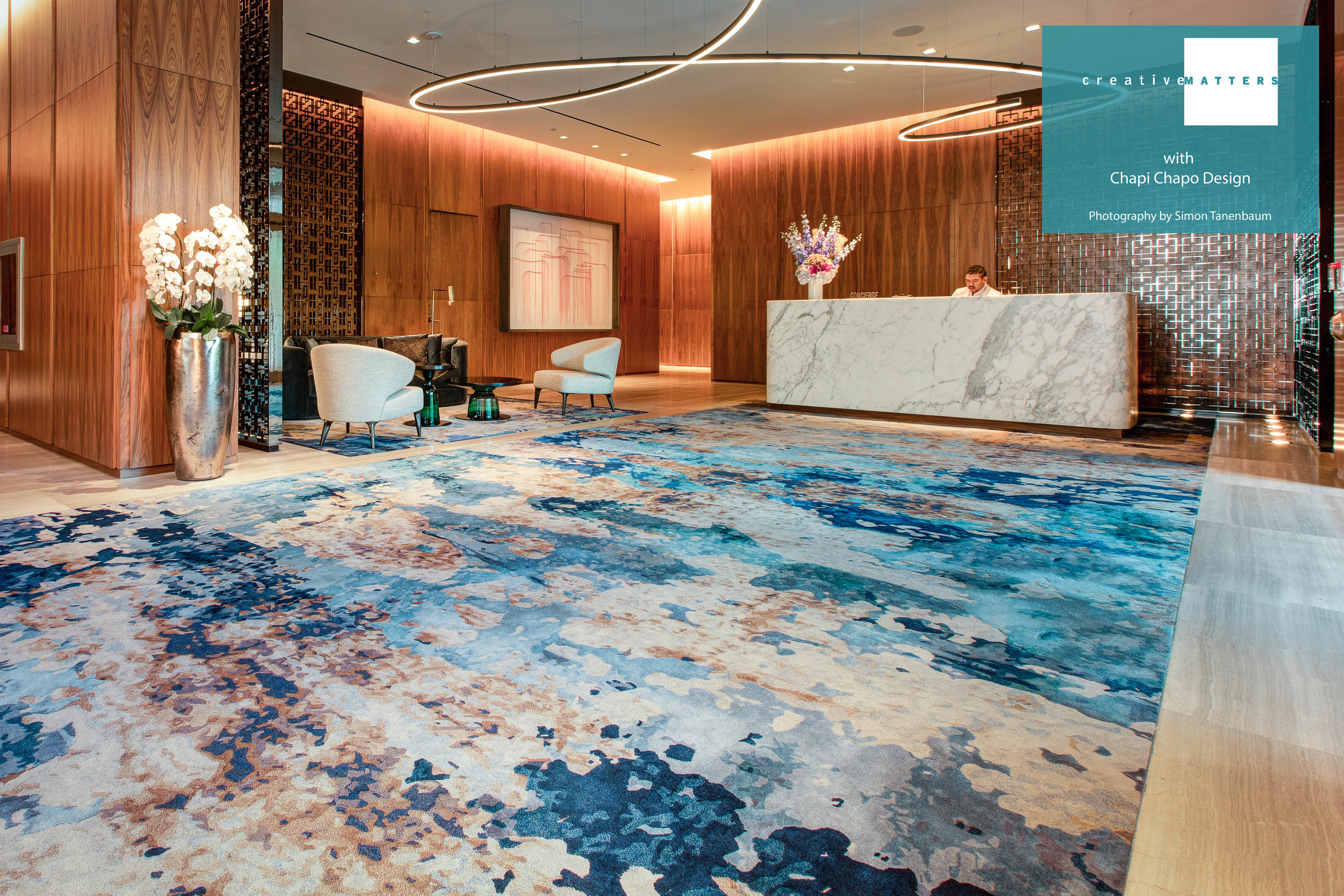 This exciting rug plays the role of a gigantic abstract painting bringing colour, drama and texture to the lobby of a particularly luxurious building. The brushstroke feel has been created by the imaginative and artisanal construction of various levels of cut and loop pile in a variety of colour blends. The wash of cool tones adds to the painterly effect while the warm tones capture the walnut wall feature. The highly sophisticated rug is part of a collection for the lobby – we also created one for the sitting area, a set of runners for the elevators and special pieces for the elevator cabs.  Project: Toronto private residences lobby Rug: handtufted wool and shiny nylon Interior Designer: Chapi Chapo Design Creative Matters Designer: Anna Panosyan