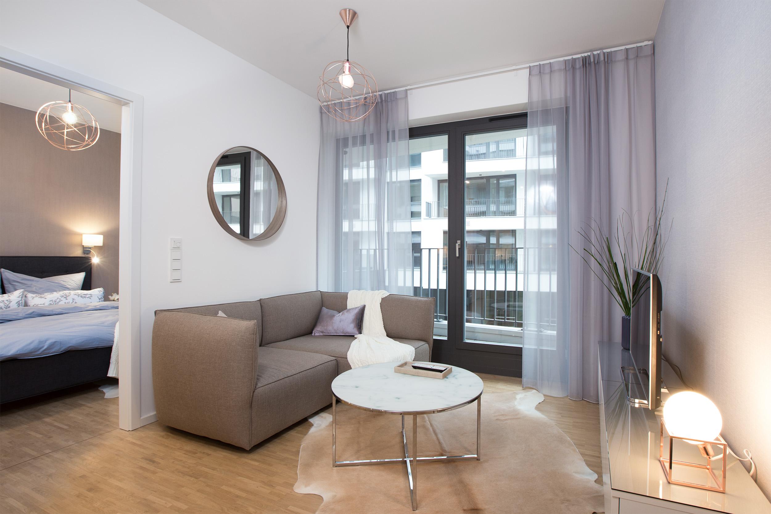 re-vamp+möbliertes+Mikropapartment+WE+145+Wohnzimmer.jpg