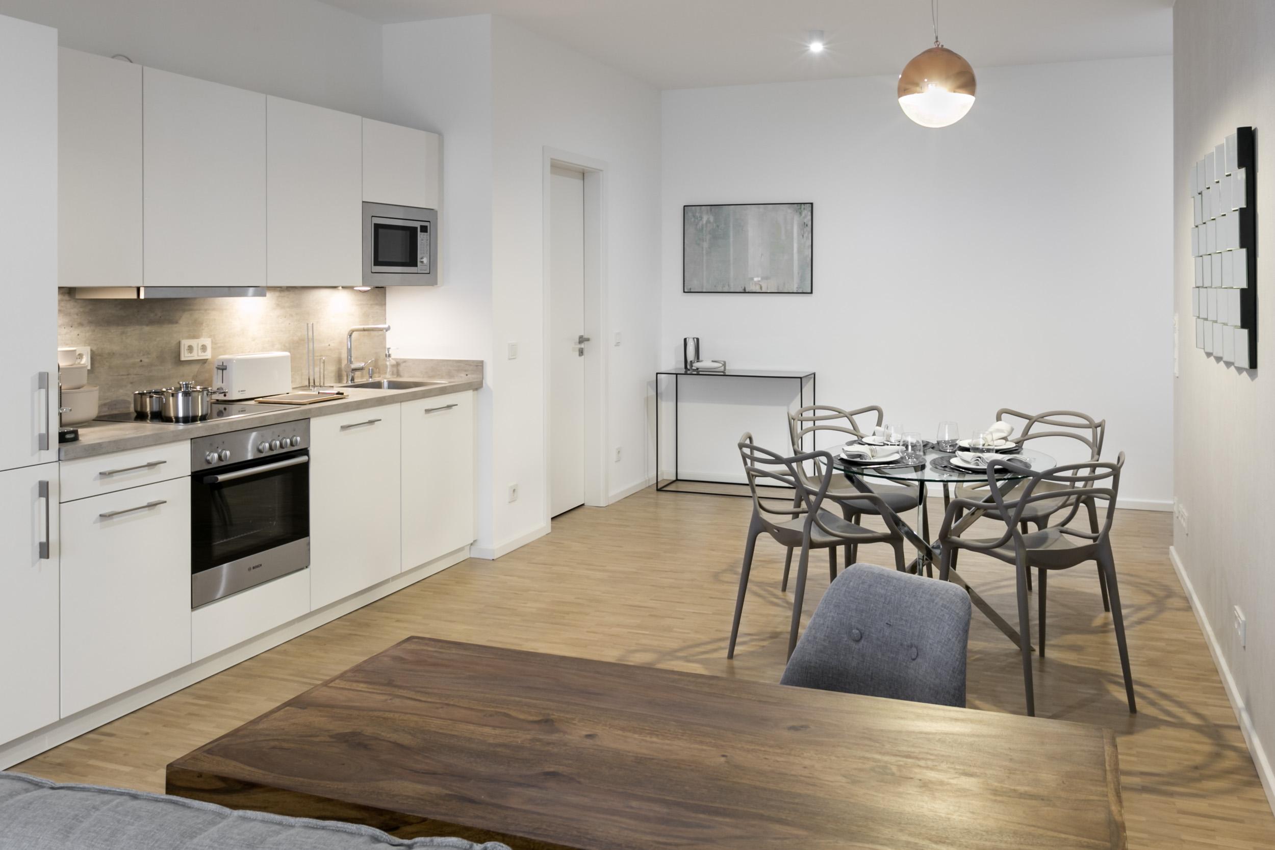 re-vamp+möbliertes+Mikropapartment+WE+153+Wohnzimmer_Küche.jpg