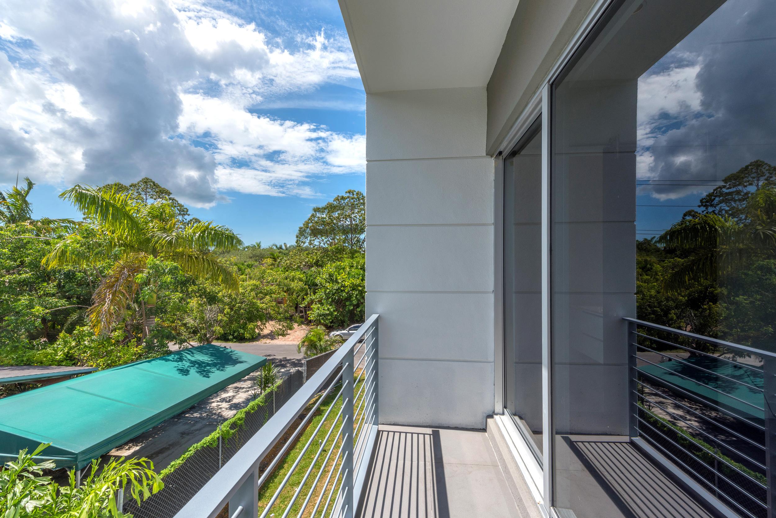 The Setting Homes Plum House Miami Florida Interior Bedroom Balcony TARIS Real Estate