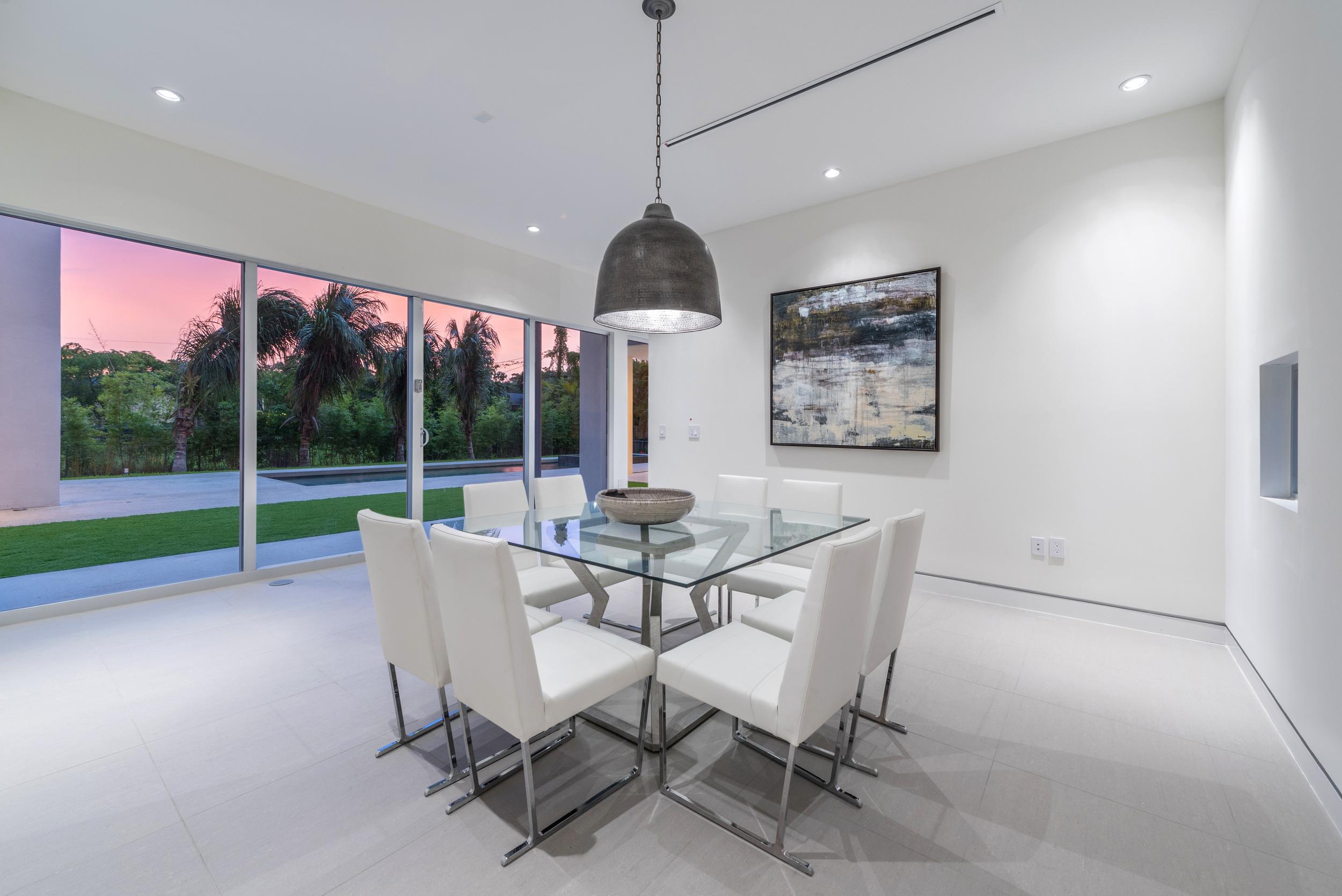 The Setting Homes Plum House Miami Florida Interior Dining Room Dusk TARIS Real Estate