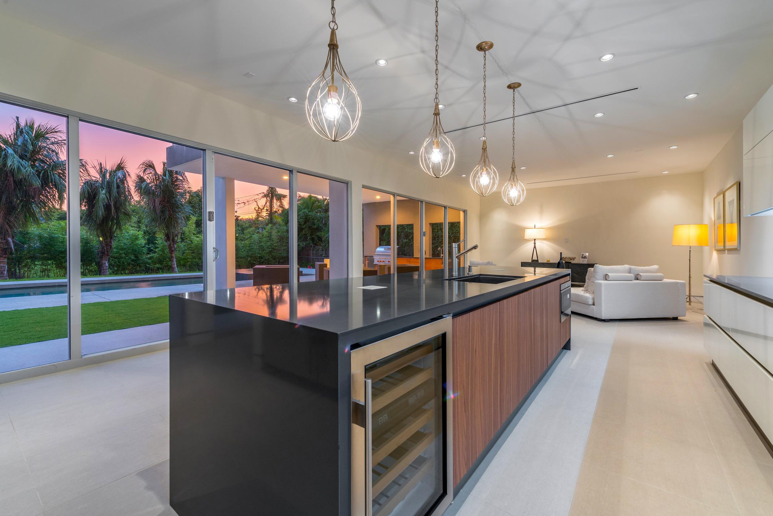The Setting Homes Plum House Miami Florida Interior Kitchen Dusk TARIS Real Estate