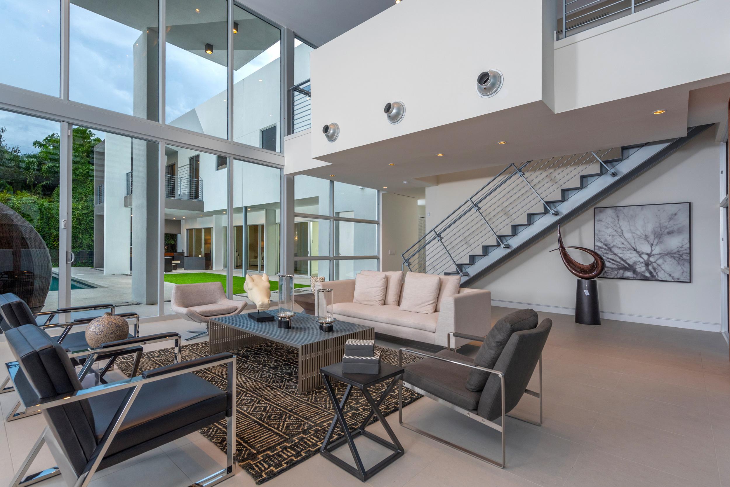 The Setting Homes Plum House Miami Florida Interior Living Room Dusk TARIS Real Estate