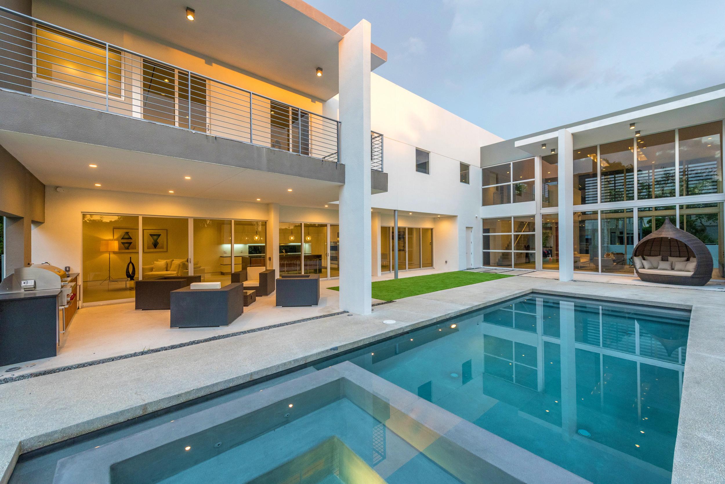 The Setting Homes Plum House Miami Florida Exterior Pool Dusk TARIS Real Estate