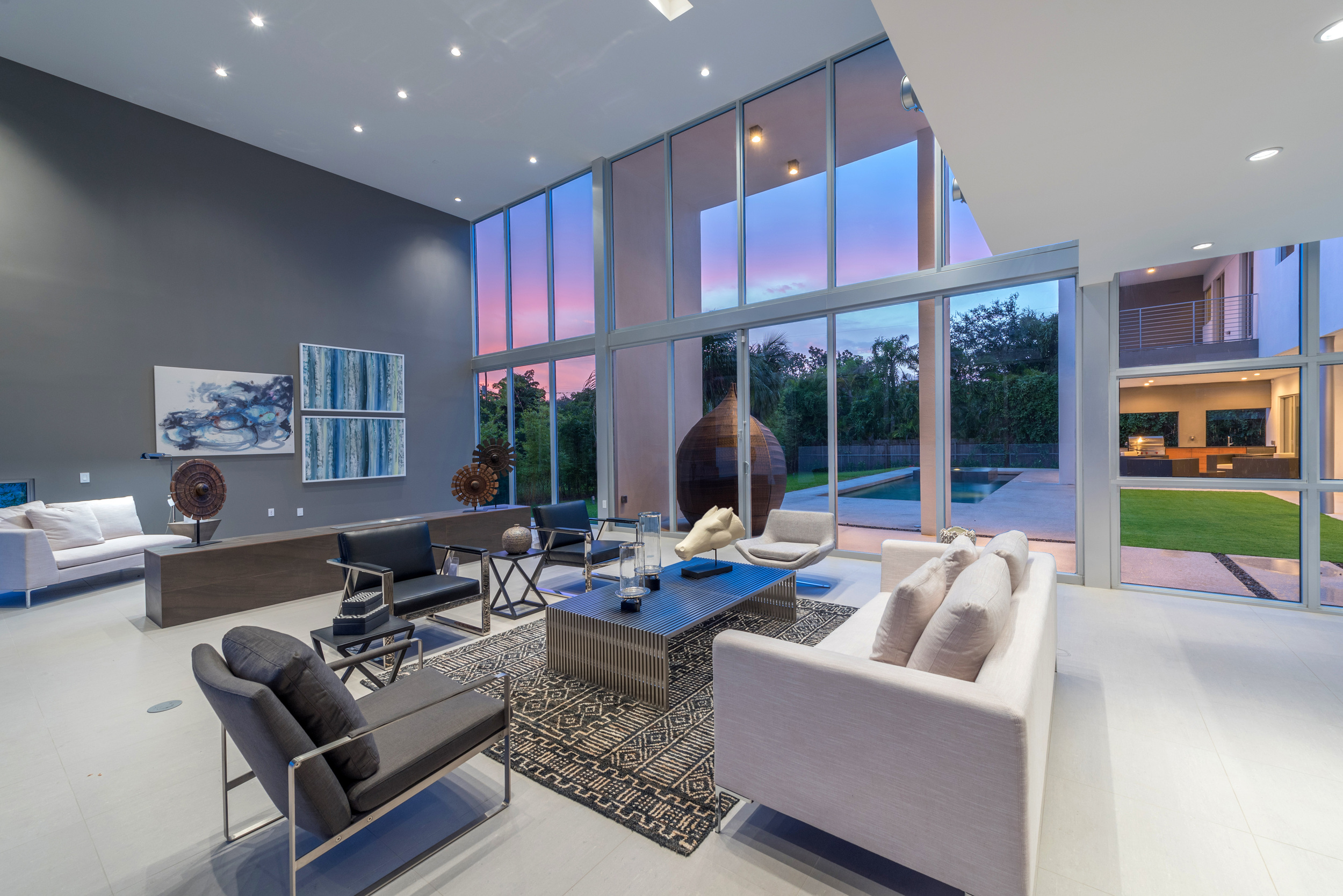 The Setting Homes Plum House Miami Florida Interior Living Room Dusk TARIS Real Estate