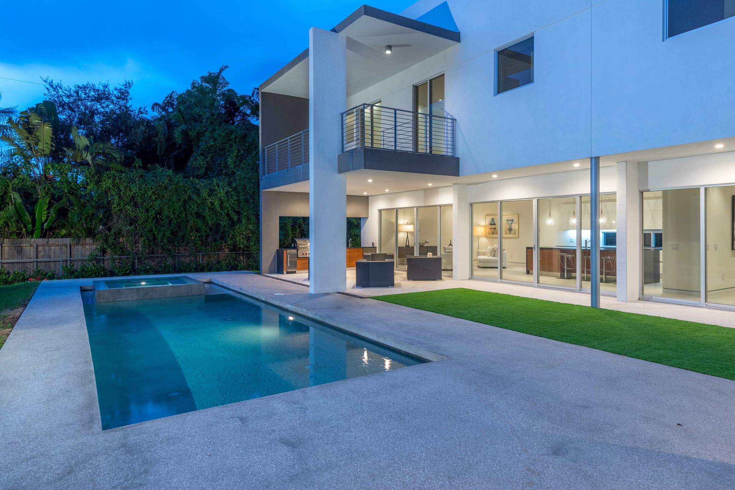 The Setting Homes Plum House Miami Florida Exterior Pool Night TARIS Real Estate