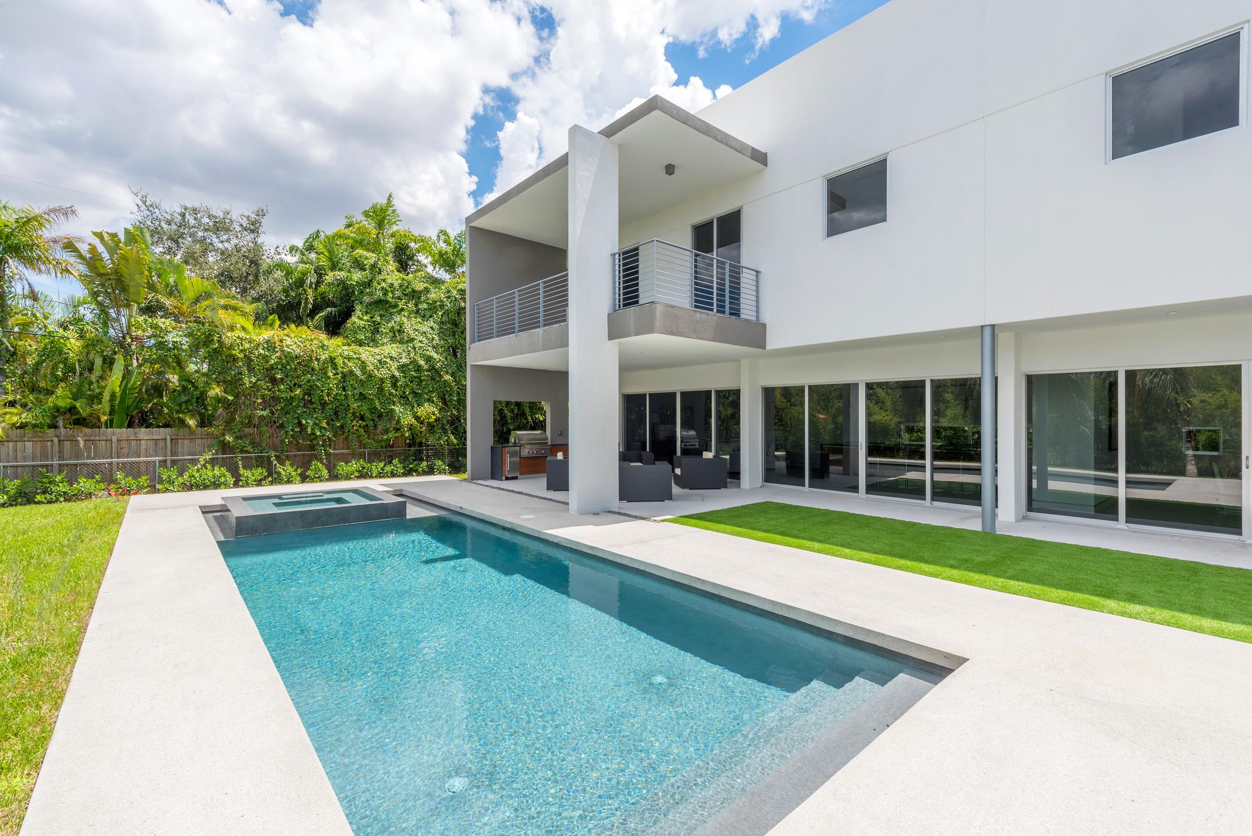 The Setting Homes Plum House Miami Florida Exterior Rear Pool TARIS Real Estate