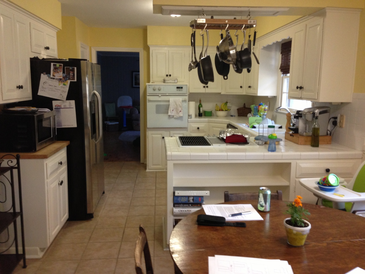Before: A quaint, traditional space that has failed to adapt to modern life - mismatched and cramped, limited work and storage space, outdated and oversized appliances.