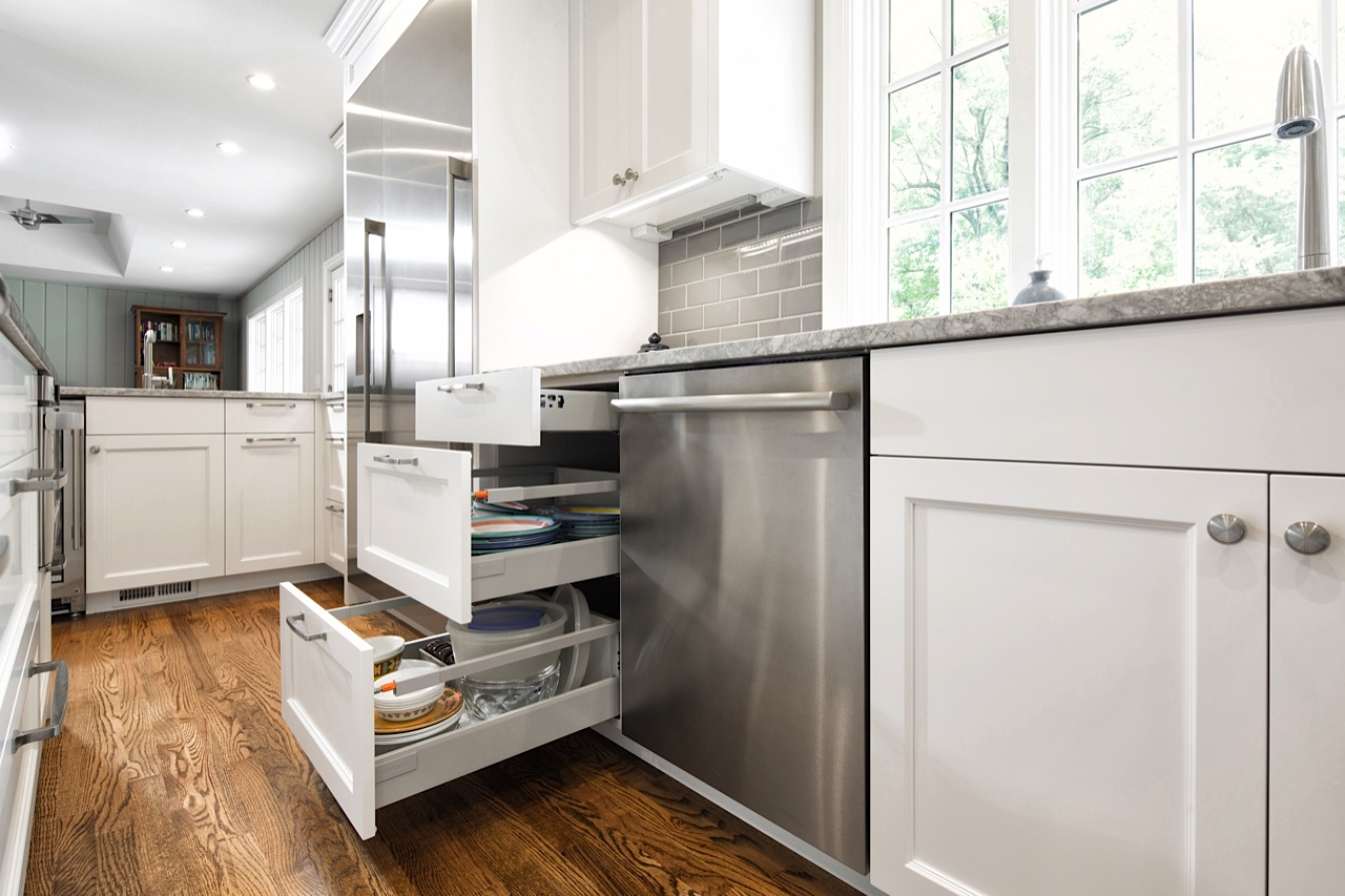 Functionality: Dish storage next to the dishwasher, with drawer heights optimized for the homeowner's unique dinnerware. Stainless steel finish extends from the faucet, to appliances, to pulls, to ceiling fan. A subtle backsplash and clean undercab lighting unify the design.