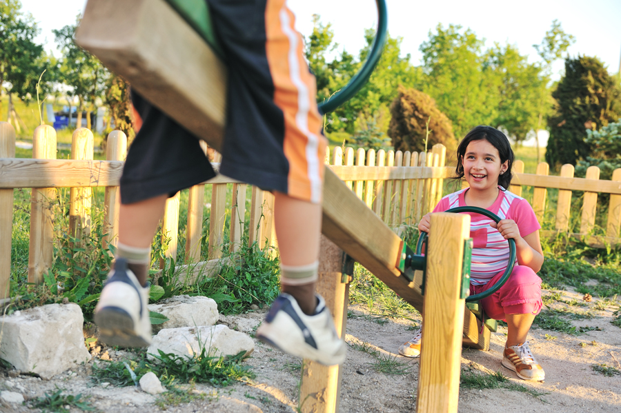 kids-playing-see-saw-at-playground-boy-and-girl_SKgztHTri.jpg