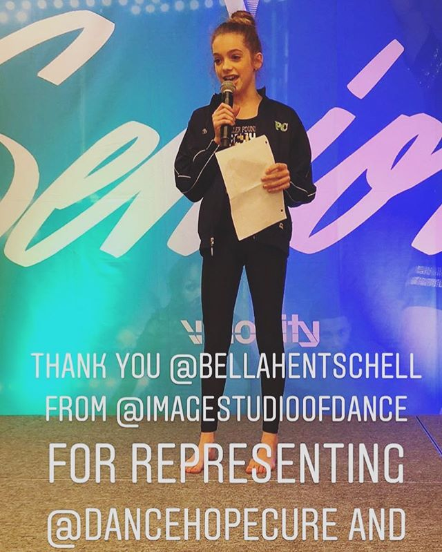 Check out our student, Bella Hentschell, speaking at the charity class at @velocitydanceconvention this weekend. Bella is a national ambassador for @dancehopecure to help bring awareness to childhood cancer. She is spreading her light and positivity with the world and we could not be more proud! #teamISOD #dancehopecure #velocitydanceconvention #changeyourperspective 💙💚💙 @bellahentschell