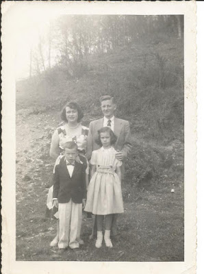 My grandparents with my father and aunt. Easter, 1950s