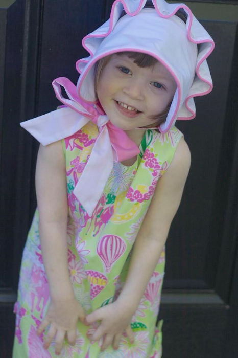 Katherine Belle F. in a Derby-themed Lilly dress and a Beaufort Bonnet.