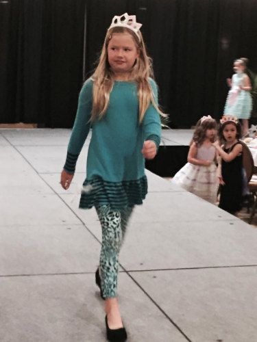 Heidi P. Walks the runway at the Derby Princess Tea