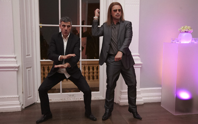 George Clooney and Brad Pitt dance at a 2013 Oscars after-party.