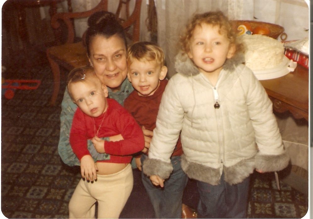 My grandma with my cousins and me, just before she got sick.
