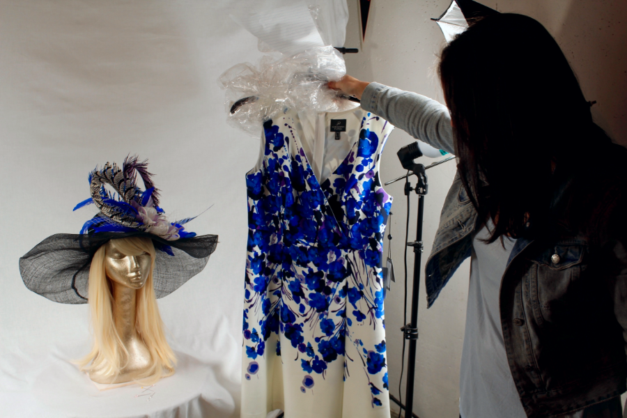 Kate Walsh of The Hat Girls shows a hat that was custom-made to match a client's Derby Dress.