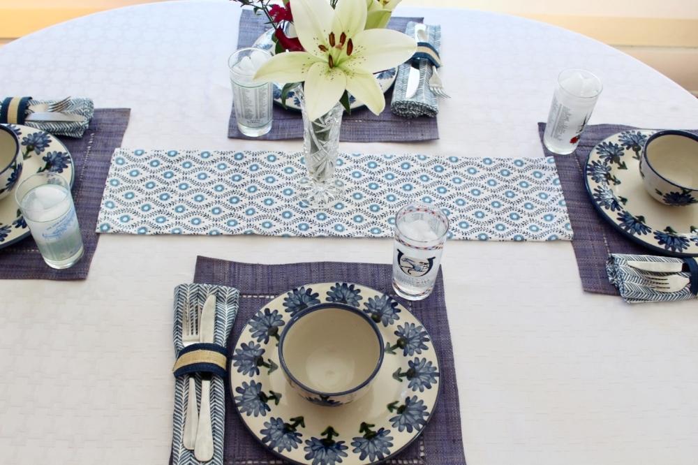 Raffia Indigo Napkin Rings, Provence Blue Tea Towel, Indigo Napkins, and Blue Raffia Hemstitch Placemats c/o Pomegranate Inc