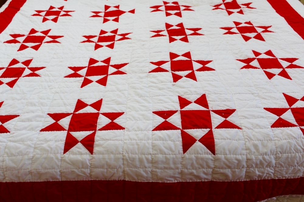 A red and white Ohio Star quilt that my grandmother made for me
