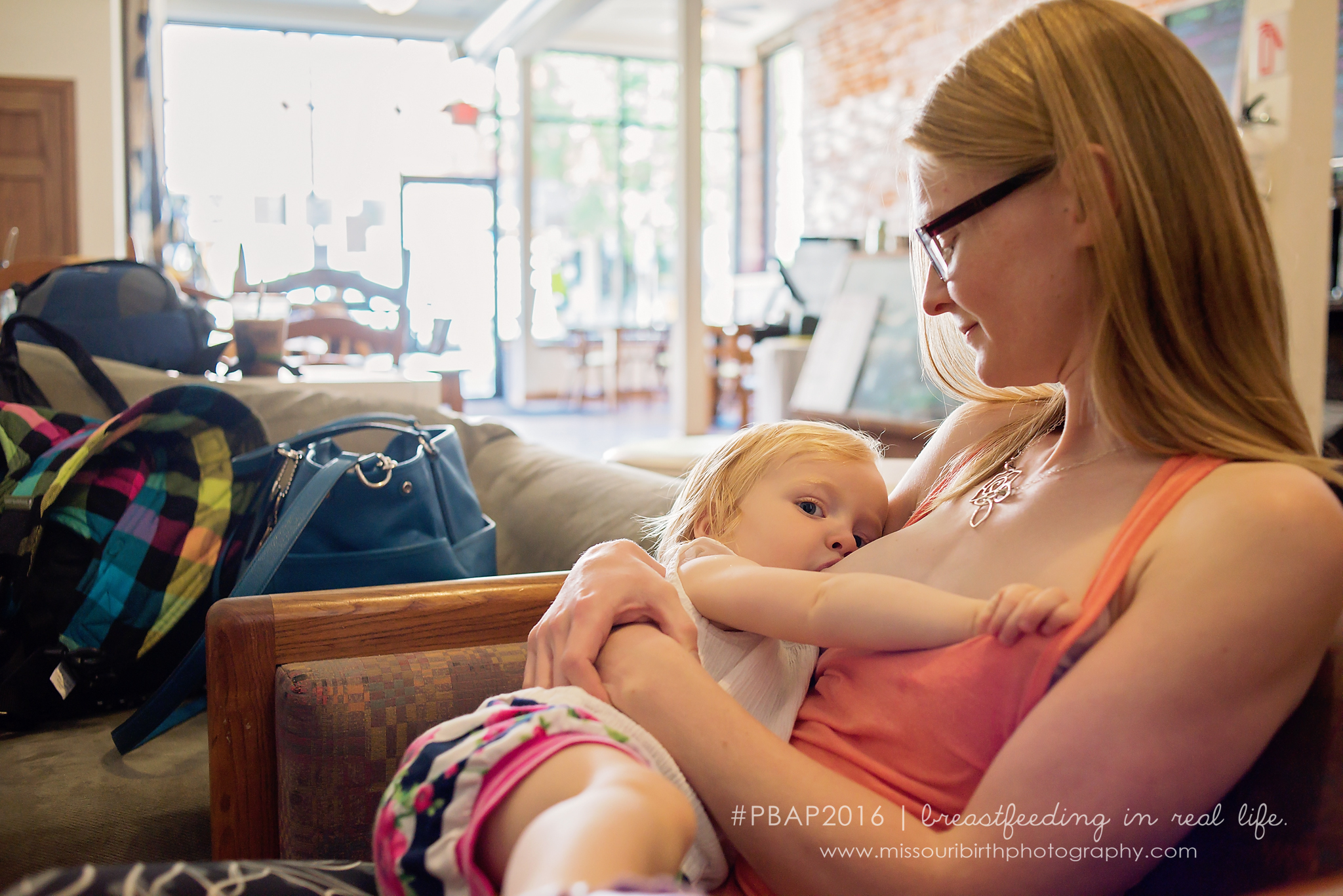 """""""Breastfeeding is, as my husband calls it, the best tool in our joint parenting toolbox. It's more than just nourishment, it's comfort and safety and love all wrapped up along with the milk. And that's part of why I don't think twice about nursing in public. Why wouldn't you utilize the most effective tool you've got?""""      - Emily and Rose (18 months)"""