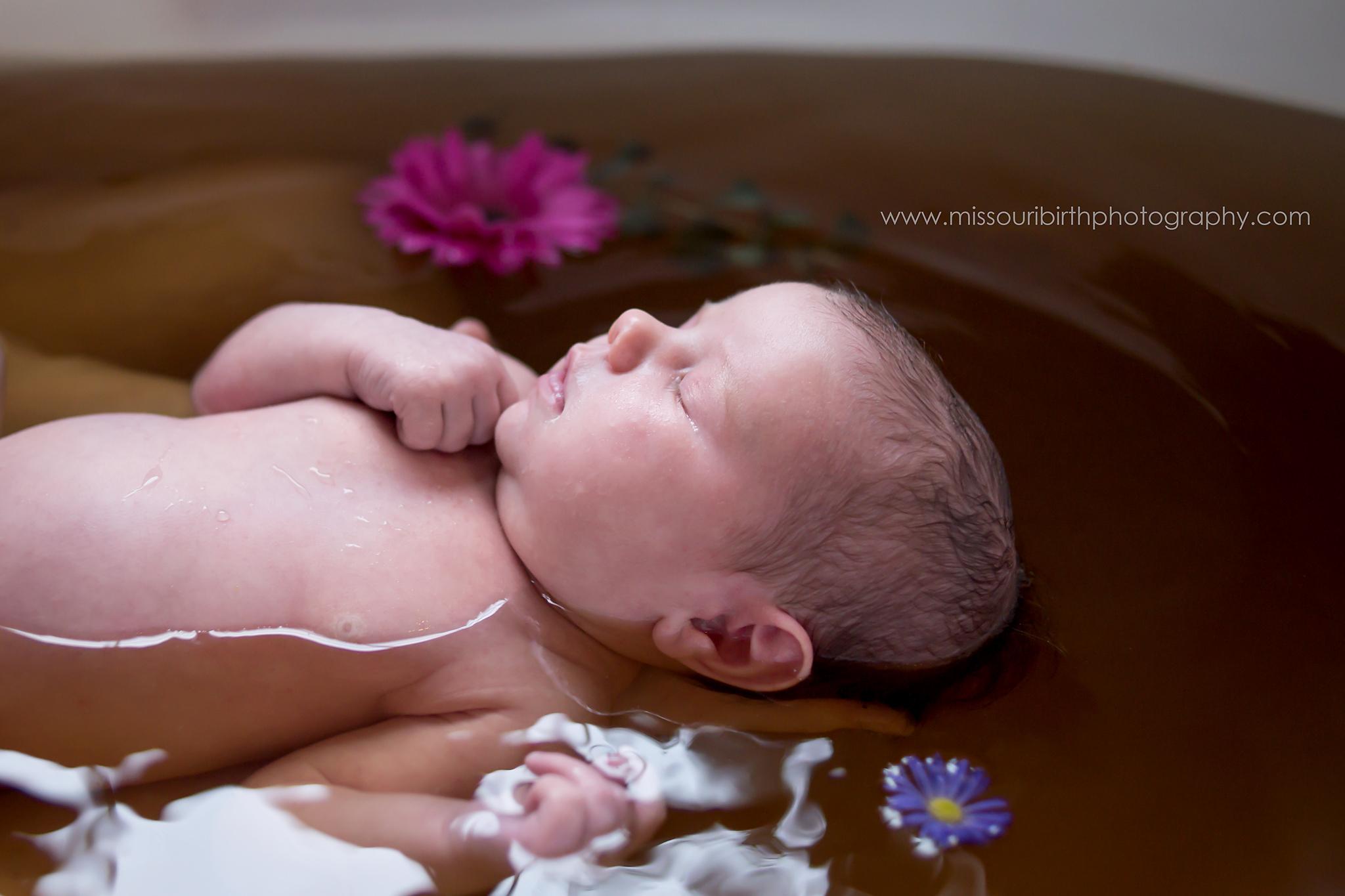 Sleeping newborn herbal bath fresh flowers
