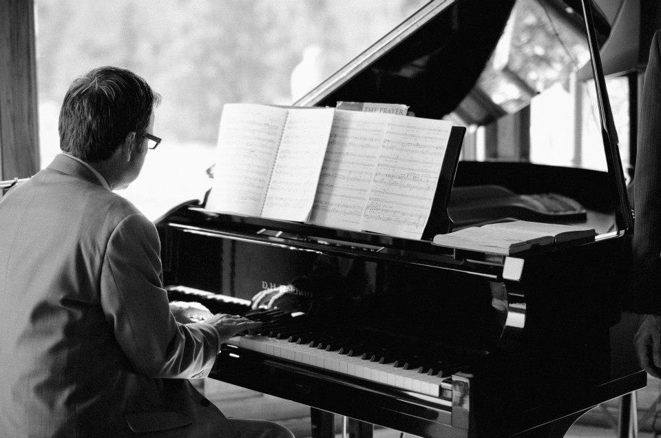 Playing piano for his niece's wedding