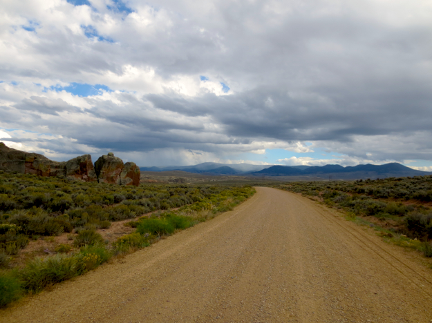 North of Hwy 50, looking back at a solid rain shower hovering over the area we'd just ridden through. We had seen two separate Tour Divide route through-riders in the last 20 miles, going southbound - looked like they were getting wet now.