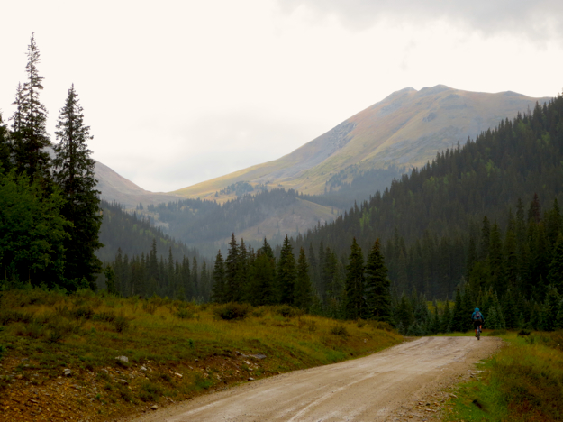 Eventually we just packed up and hit the road, hoping to get over 12,000' Cumberland Pass without getting struck by lightning.  I actually enjoy riding in the rain - you get so many sweet vistas like this one.