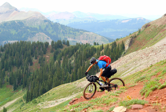 Ready to reap the downhill rewards! (Photo by Scott Morris)