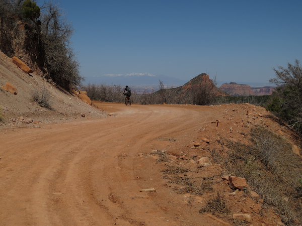 Climbing into the mountains.  The La Sals outside of Moab are visible in the distance, still snow-covered.