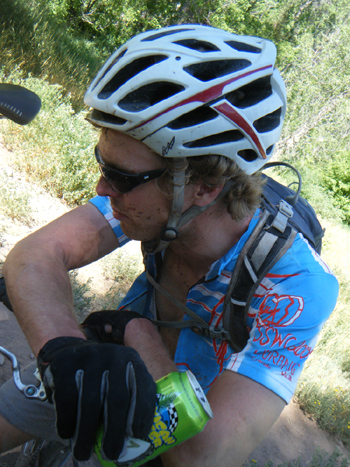 Robin after the 2011 Durango Dirty Century with his favorite recovery drink... his favorite warm-up drink, too, at that. (Chad Cheeney photo)