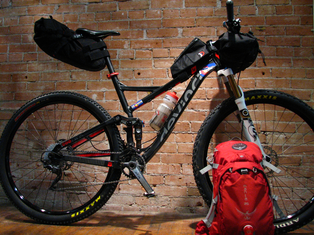 Joey's previous bike, a Devinci Atlas, ready to go for the 2013 CTR.  Bedrock Bags' Entrada handlebar bag/pocket and Revelate Designs' Gas Tank and Viscacha seatbag, used in conjunction with Osprey's Manta 25 pack, provided plenty of room.
