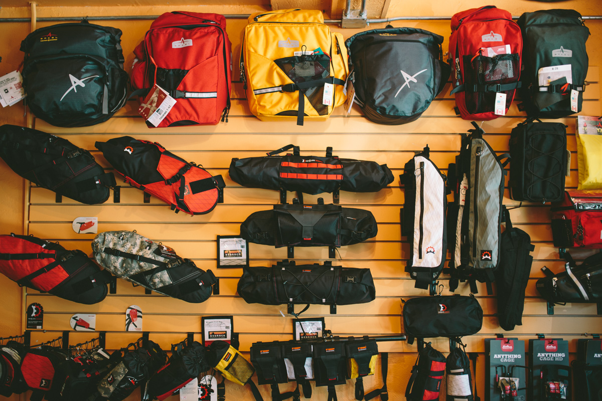 Our bikepacking / touring wall as of several weeks back. Generally lots more in backstock - just not right now. Photo cred: Logan from Pedaling Nowhere!
