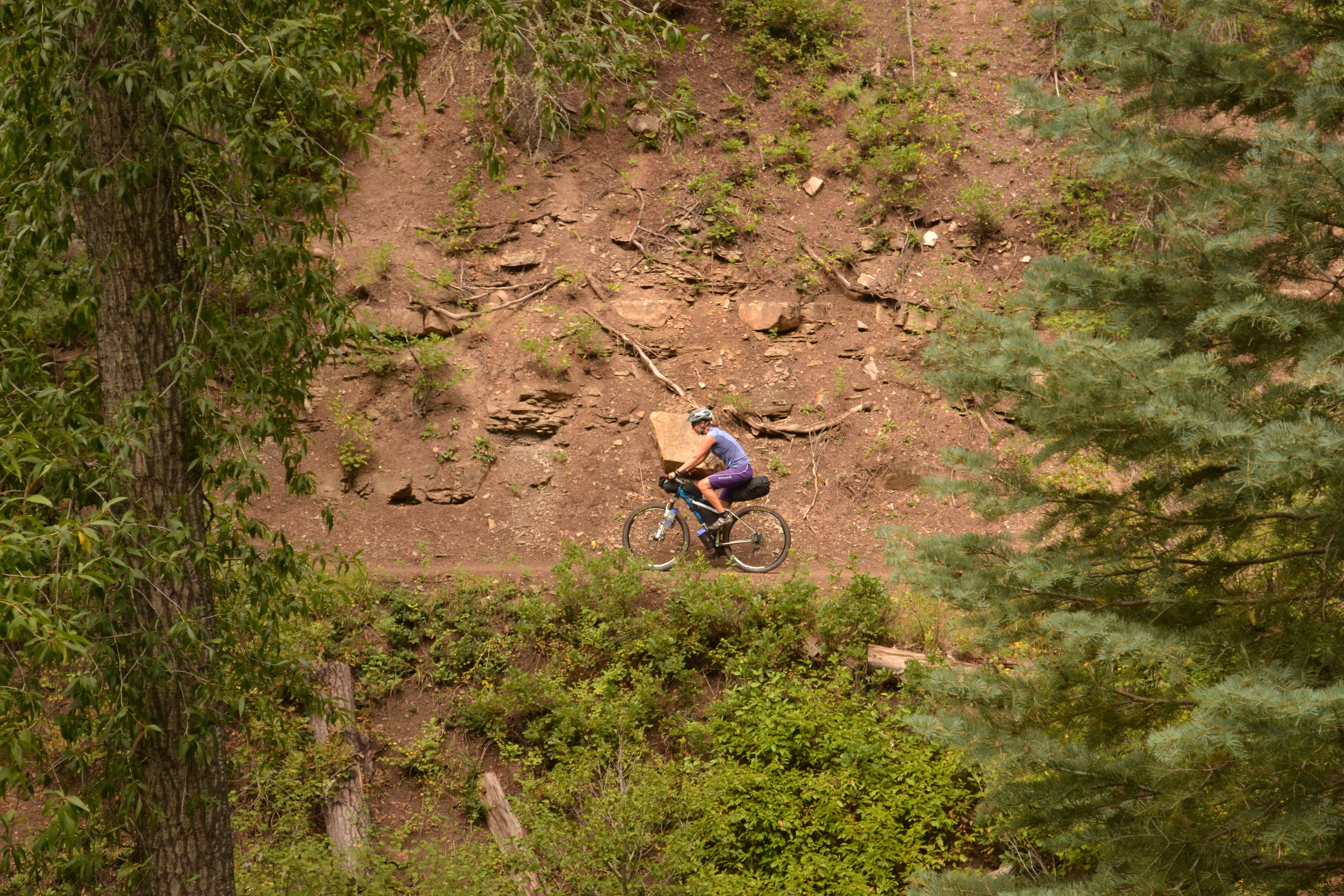 Sandhya, riding through the woods. (Photo by Brian Hanson)