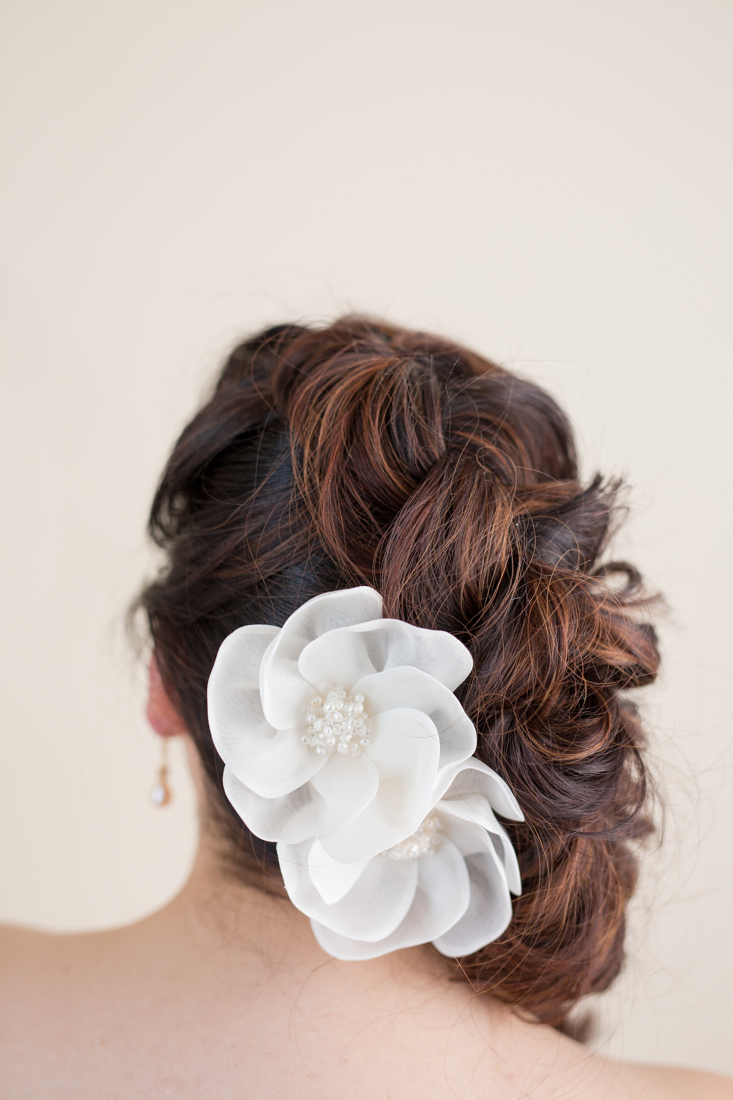 Organza flowers accented with pearls add some fun to any wedding hairstyle