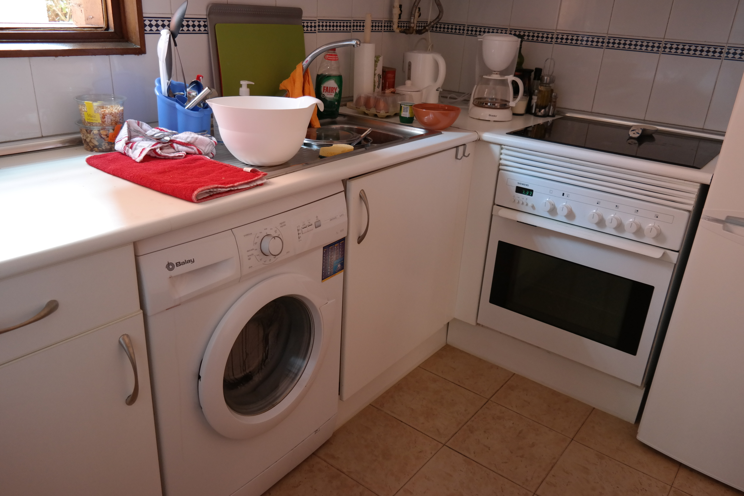 Yep, our washing machine is in our kitchen! Nothing like multi-tasking.