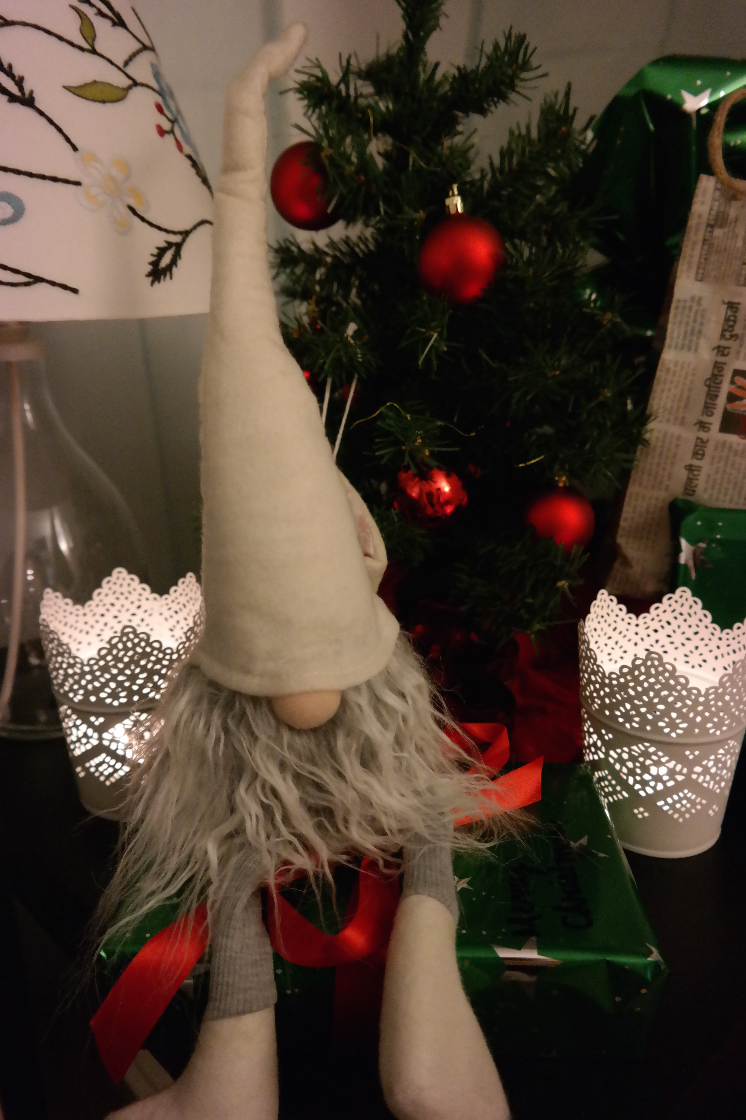 Our shelf-elf Otto presides over the gifting station. And yes, he's about the same size as our tree.
