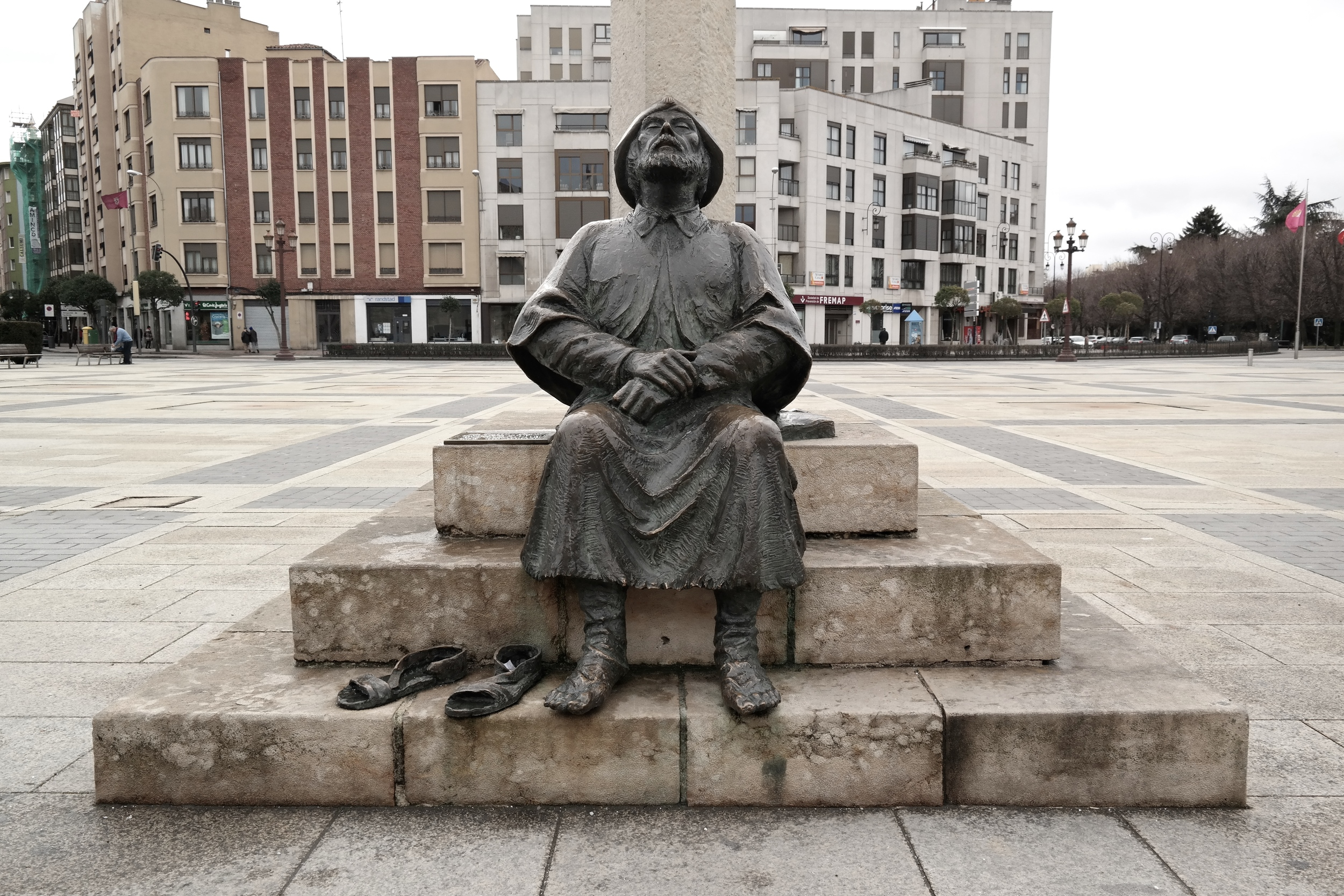 Statue of a weary pilgrim in front of the hotel.