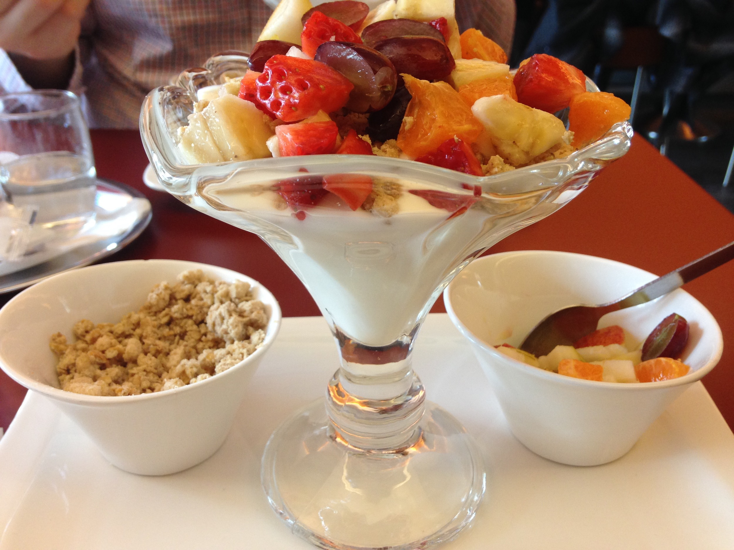 Austrian Breakfast of Champtions: creamy yogurt, chopped fruit, and the best granola I've ever had. My mouth is watering.