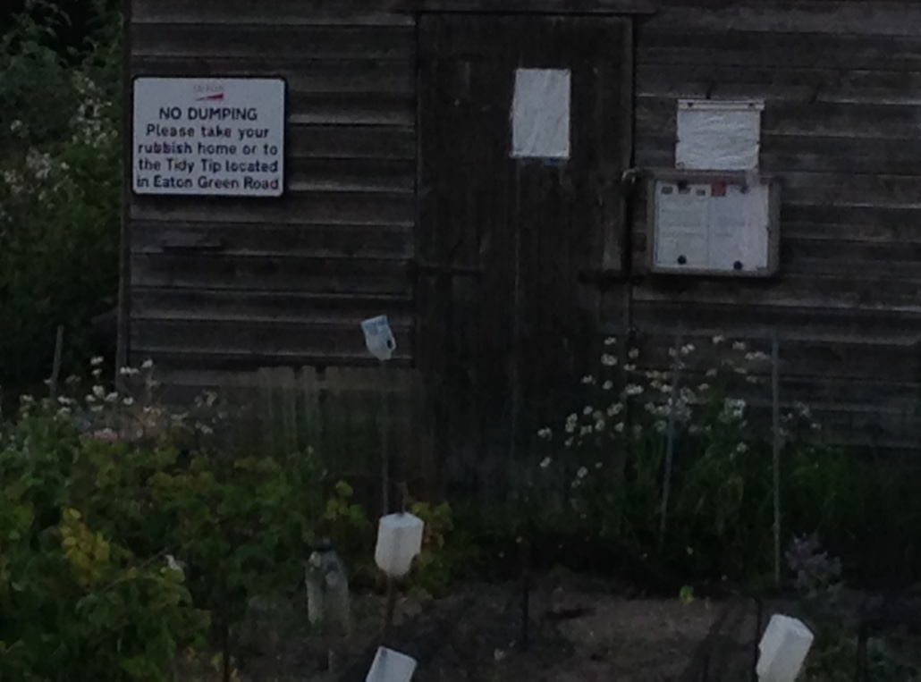 """No dumping. Please take your rubbish home or to the Tidy Tip located in Eaton Green Road.""  So many British-isms here: 1) rubbish, 2) Tidy Tip (I feel like only Brits would call a trash dump by this name), 3) ""in"" instead of ""on"", and 4) continuing to say ""please."""