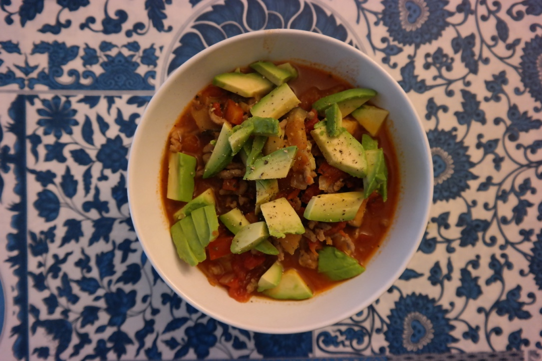 Beef and veggie chili, topped with avocado . I made up this recipe as I went, too, and it was both very satisfying AND a great way to get about 4 meals (or more!) out of one pot! I used ground beef, canned tomatoes, eggplant, zucchini, and bell peppers, plus chili seasoning, salt, and pepper.
