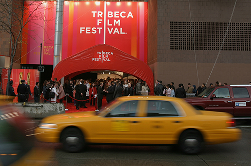 Taxi_passes_TFF_Open_Ceremony_Red_Carpet_01-cropped.png